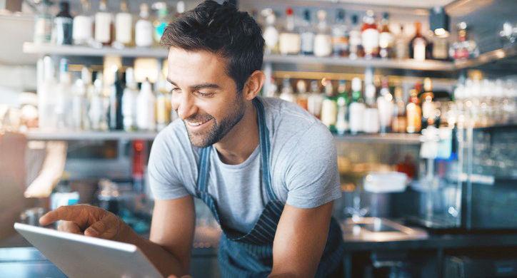 Restaurant manager using tablet