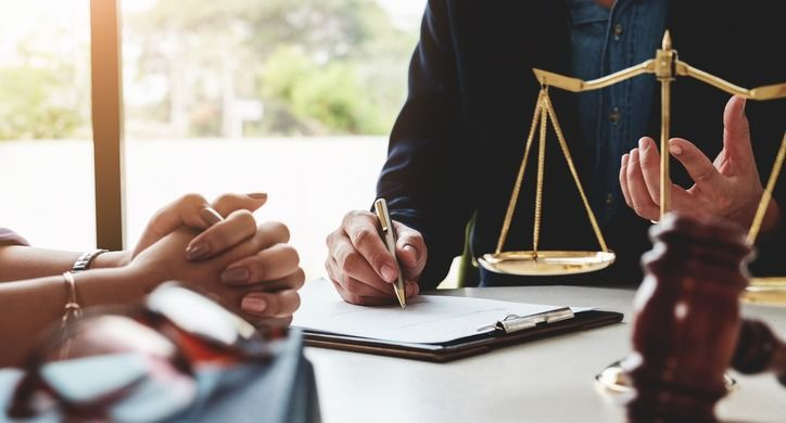 Employment lawyer with client